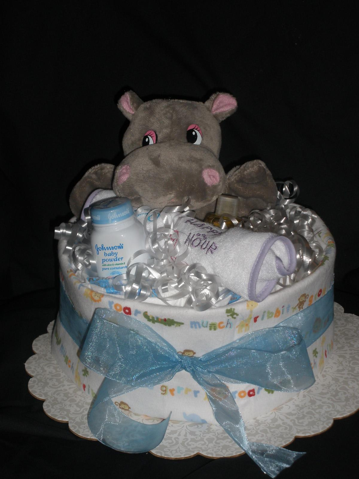 Hippo hand puppet12 size 1-2 diapers1 Recieving blanket1 Bib1 trial ...